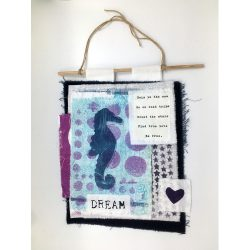 blue seahorse prayer flag with bohemian quote